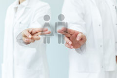 Two doctors supporting prevention or equality. By pushing touchscreen icons Stock Photo