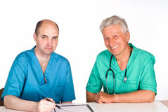 Two doctors at table Stock Photography