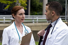Two Doctors Talking Royalty Free Stock Photos