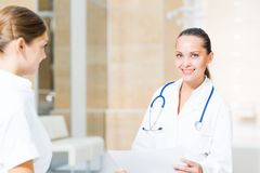 Two doctors talking in the lobby of the hospital Royalty Free Stock Image