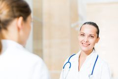 Two doctors talking in the lobby Royalty Free Stock Image