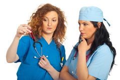 Two doctors women analyze blood tube Stock Images