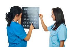 Two doctors women examine MRI Stock Photos