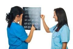 Two doctors women examine MRI stock photos