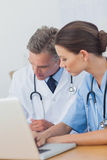 Two doctors working on a folded Stock Photography