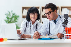 The two doctors working in the lab Stock Image