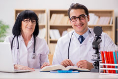 The two doctors working in the lab Stock Photo