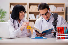 The two doctors working in the lab Stock Photos