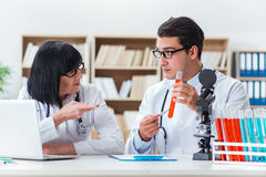 The two doctors working in the lab Stock Photography