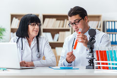 The two doctors working in the lab Royalty Free Stock Image