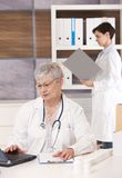 Two doctors working together Stock Photos