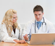 Two doctors working together Royalty Free Stock Photography