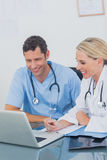 Two doctors working together on a laptop Stock Photography