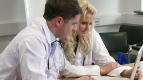 Two Doctors working together. Two Young Doctors working together stock video