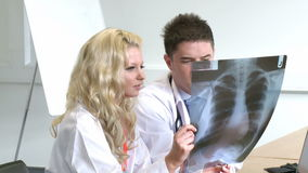 Two Doctors working together. Two Young Doctors working together stock footage