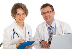Two doctors write medical reports Royalty Free Stock Photography