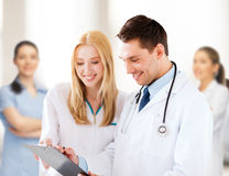 Two doctors writing prescription Royalty Free Stock Photography