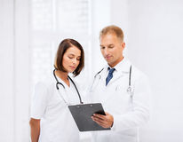 Two doctors writing prescription Royalty Free Stock Images