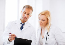 Two doctors writing prescription Stock Photo