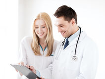 Two doctors writing prescription Royalty Free Stock Photo