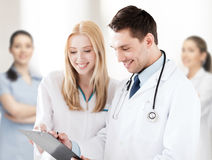 Two doctors writing prescription Royalty Free Stock Photos