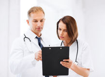 Two doctors writing prescription Stock Photo