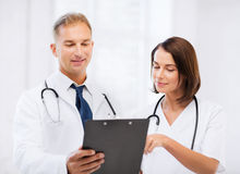 Two doctors writing prescription Stock Photography