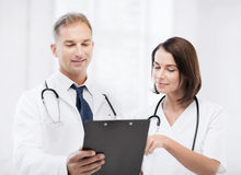 Two doctors writing prescription Royalty Free Stock Image