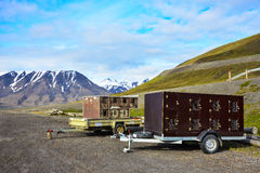 Two dog transportation trailers in Spitsbergen, Svalbard Royalty Free Stock Photo