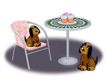 Two Dogs and three Cup Cakes. Two dogs sitting and looking at three cupcakes standing on a round table Stock Photography