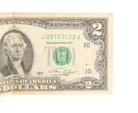Two dollar bill close. Up on white stock images