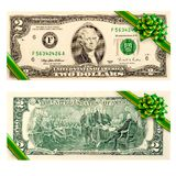 Two dollar bill gift bow. Two dollar bill gift green ribbon bow isolated on the white background royalty free stock photography