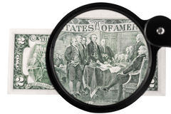 Two-dollar bill increased magnifying glass Royalty Free Stock Photography