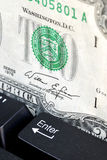 Two dollar bill and keyboard Royalty Free Stock Photo