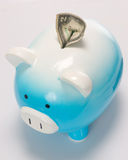 Two Dollar Bill Stuck in the Piggy Bank. On white royalty free stock photography