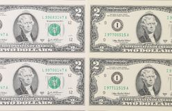 Two dollar bills background. Royalty Free Stock Photos