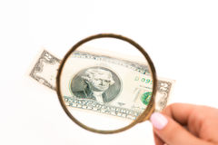Two dollars bill and magnifying glass Royalty Free Stock Photos