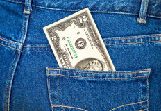 Two dollars bill sticking out of the jeans pocket Stock Photo