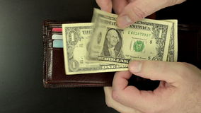 Two dollars from billfold. Man hands are taking out two dollars of billfold stock video