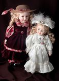 Two dolls. On the black background Royalty Free Stock Image