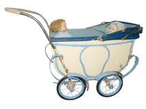 Two Dolls in an Antique Pram Royalty Free Stock Photo