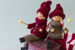 Two dolls boy and girl with christmas look. Two dolls boy and girl with nice christmas look Stock Photo