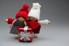 Two dolls in love on Valentines day knitted wear with heart