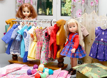 Two dolls with their clothes Royalty Free Stock Image