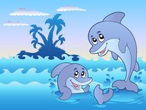 Two dolphins playing in waves Royalty Free Stock Image