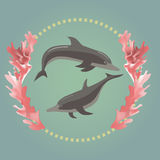 Two dolphins with the seaweeds. Two dolphins in the ring with the seaweeds Stock Photos