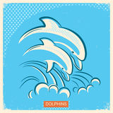 Two dolphins.Vector retro illustration of parent and baby underw Stock Image