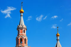 Two domes of orthodox church with golden crosses against the blue sky Royalty Free Stock Image