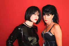 Two Dominatrix Women. Stare straight down the camera Stock Images