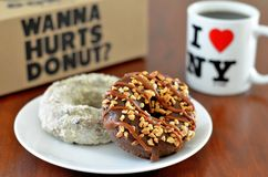 Two donuts and cup of coffee. Perfect breakfast in USA. Two donuts and a cup of coffee stock photos
